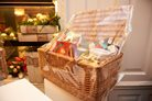 christmas hamper basket with gifts inside