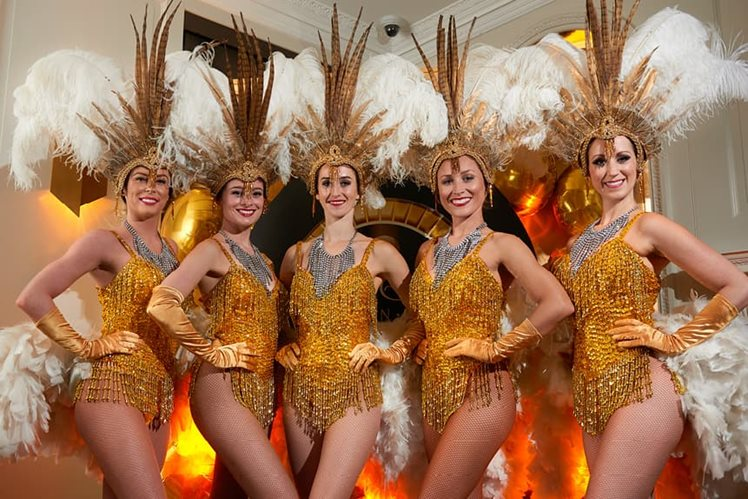 performers dressed in gold