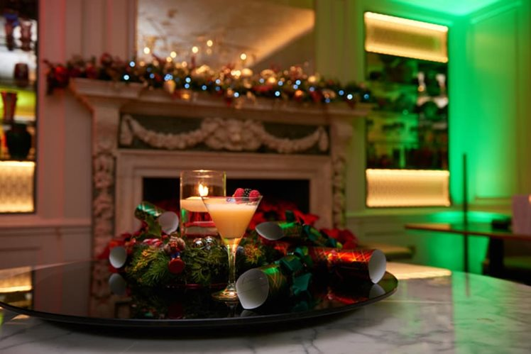 candles and christmas decorations at crown london aspinalls