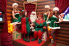 santa and elves at the crown london aspinalls vip christmas party