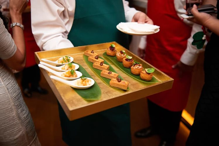 canapes handed around by a waiter